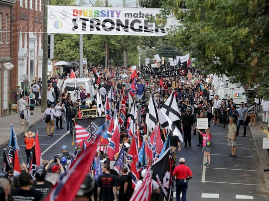 "Hundreds of white nationalists, neo-Nazis and members of the ""alt-right"" march down East Market Street toward Lee Park during the ""United the Right"" rally August 12, 2017 in Charlottesville, VA."