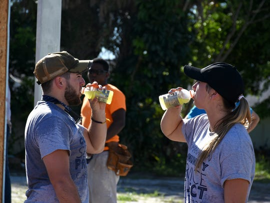 Thomas DeMaio and Kaitlin Coyle rehydrate after some hot and thirsty work.