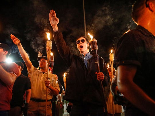 """Multiple white nationalist groups march with torches through the UVA campus in Charlottesville on Aug. 11, 2017. When met by counter protesters, some yelling """"Black lives matter,"""" tempers turned into violence. Multiple punches were thrown, pepper spray was sprayed and torches were used as weapons."""