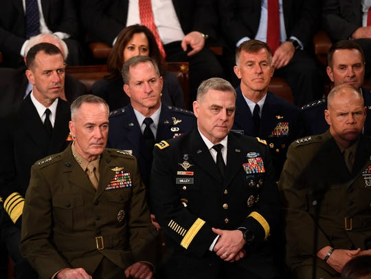 The Joint Chiefs of Staff listen as President Donald
