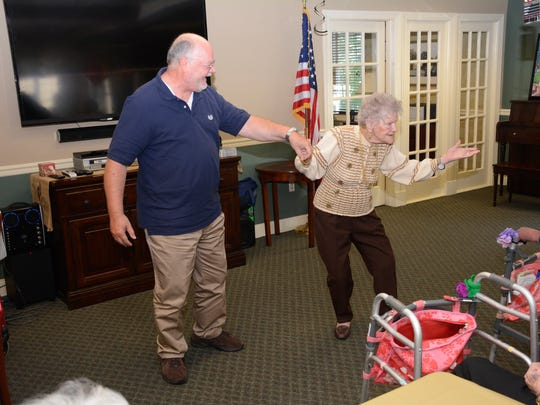 Ann LaHoff demonstrates a dance step with nephew Michael Miller.
