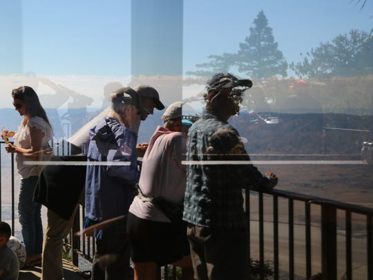 Visitors watch the eclipse from the deck of the Palm