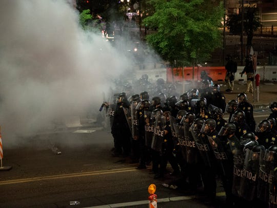 Riot police deploy gas on protesters after President