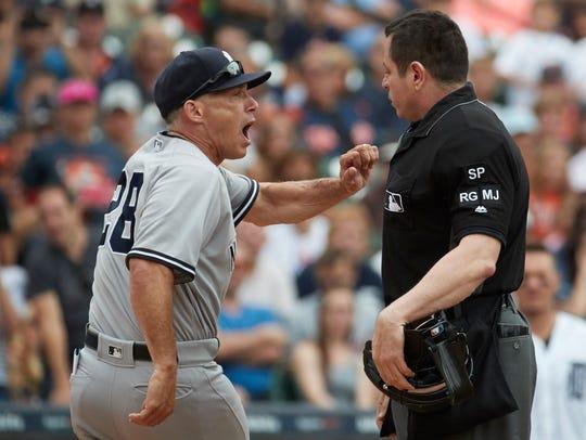 New York Yankees manager Joe Girardi (28) argues with