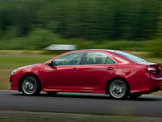 This undated photo provided by Toyota shows the 2012 Toyota Camry. Toyota didn't change much in terms of looks on the 2012 Camry, but the base four-cylinder engine got a big upgrade to 178 horsepower. (Toyota)