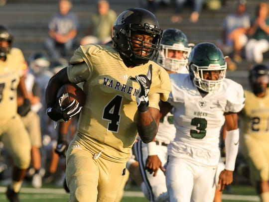 Warren Central receiver David Bell looks for space