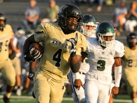 Warren Central receiver David Bell looks for space in the Warriors' one-point loss to Louisville Trinity (Ky.)