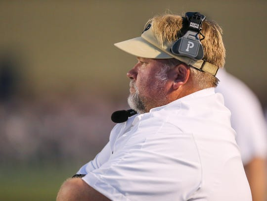 Pearl head football coach John Perry watches as his