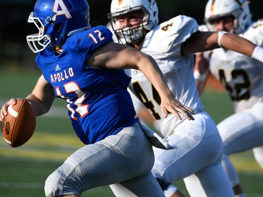 Hunter Reason (44) of Central chases down the Apollo quarterback in the Independence Bank Border Bowl played at Steele Stadium in Owensboro, August 25, 2017.