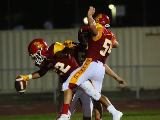 Palm Desert players celebrate after a touch down, Friday,