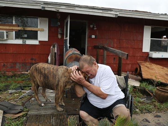 Steve Culver cries with his dog Otis as he talks about