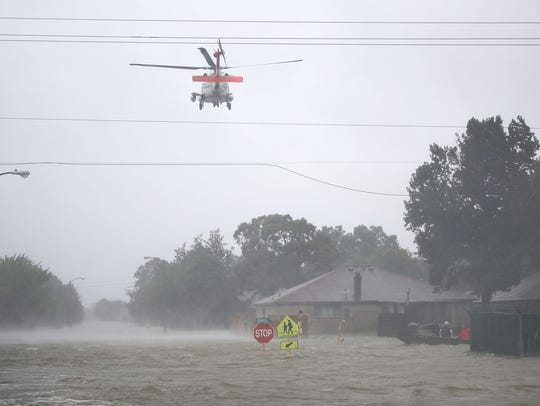 HOUSTON, TX - AUGUST 28:  A Coast Guard helicopter