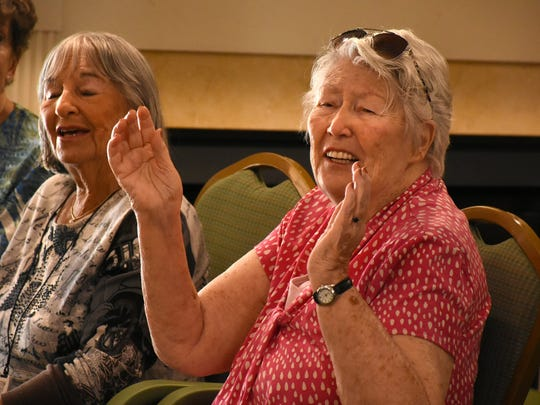 "A resident at the Inn at Aston Gardens claps along to the music as ""Velvet Touch"" performs."