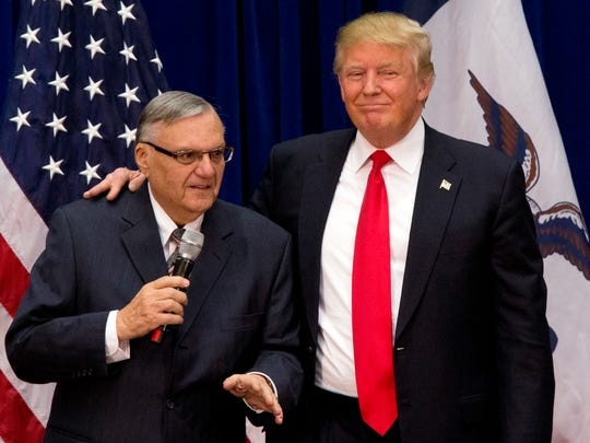 In this Jan. 26, 2016 file photo, then-Republican presidential candidate Donald Trump is joined by Joe Arpaio, the sheriff of metro Phoenix, at a campaign event in Marshalltown.