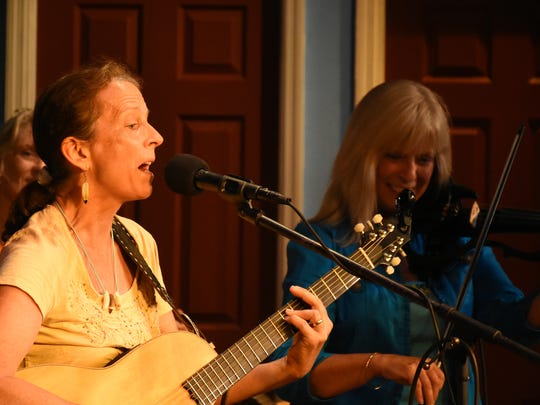 """Sawgrass"" Cindy Hackney sings one of her nature-themed songs. J.Robert hosted the Florida Songwriter Showcase, with a series of Sunshine State songwriters playing and singing their compositions on Monday evenings at the Marco Players Theater."
