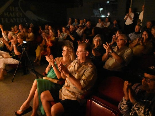 The crowd, including musician Jeff Hilt, center, applauds Andy Wahlberg. J.Robert hosted the Florida Songwriter Showcase, with a series of Sunshine State songwriters playing and singing their compositions on Monday evenings at the Marco Players Theater.
