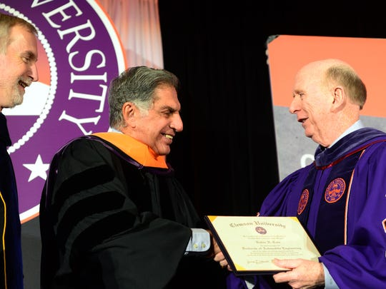 Ratan Tata, former chairman of India's Tata Group, receives an honorary doctorate of automotive engineering from Clemson University board chairman and former ambassador David Wilkins, right, during the SC Automotive Summit at the Hyatt.