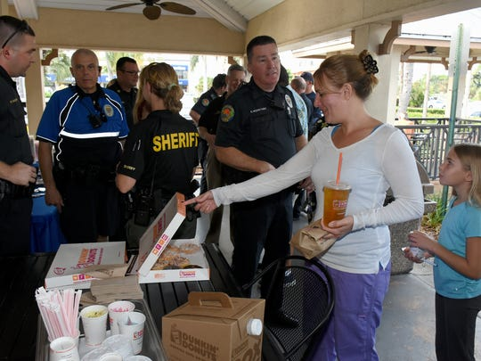 Melissa Tschida checks out the donuts. The Collier County Sheriff's Office partnered with the Marco Island Police Department and Dunkin Donuts Friday morning to offer the community Coffee with a Cop.