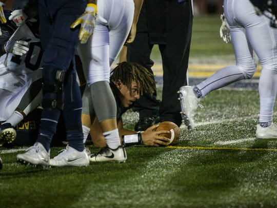 Naples High quarterback Jordan Persad-tirone rests