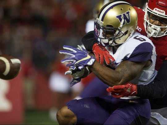 Washington Huskies vs Rutgers Scarlet Knights. 
