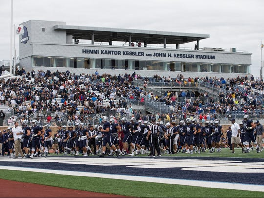 Monmouth's on the field in front of the new stadium.