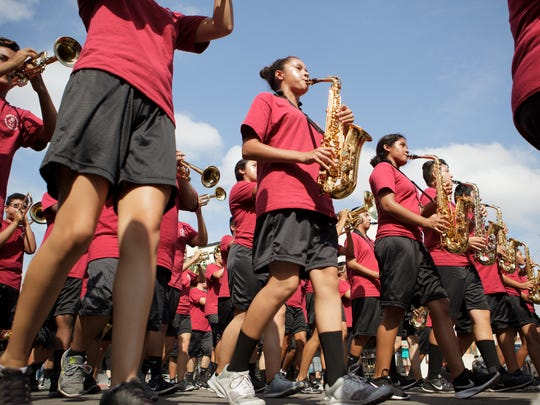 Members of Santa Paula High School marching band march down Main Street during the Labor Day Parade in downtown Santa Paula.