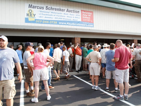 Many gathered Saturday morning for the auction of items