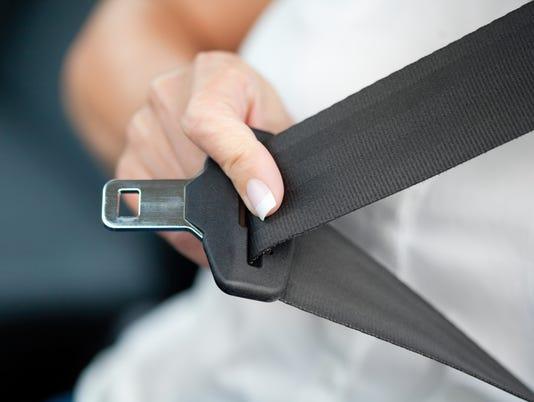 Hand pulling seat belt