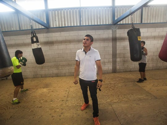 Diego De La Hoya walks through El Condor Boxing Gym in Mexicali. De La Hoya spent years as a child and winning a national championship at the age of 12.