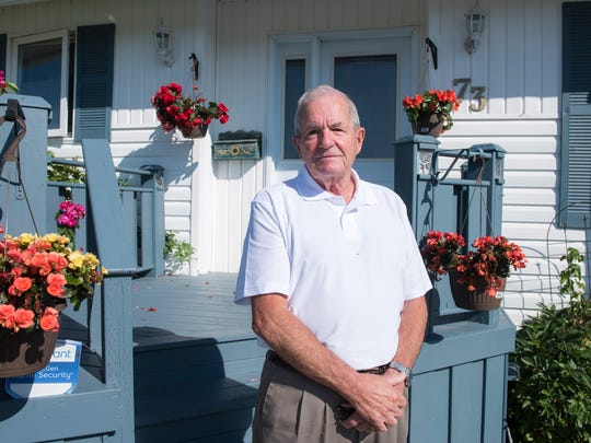 Des Dillon, a longtime Red Cross volunteer and the Chairman of the Gander Airport Association outside his home in Gander.