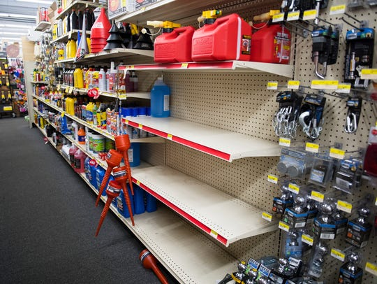 Only a few gas cans are left on the shelves in an Ace