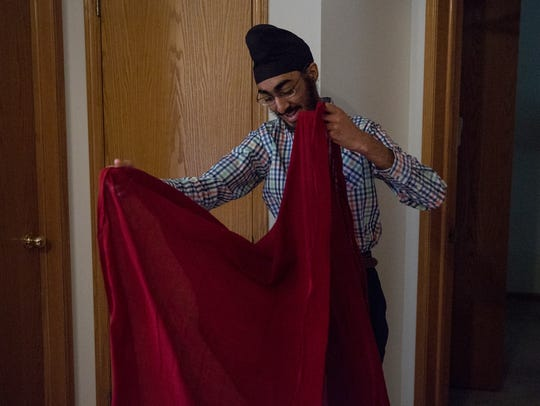 JJ Singh Kapur, folds a 15-foot long cotton cloth to