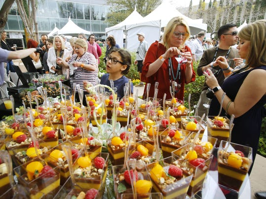 Guests enjoy food and drink during the Devour Culinary