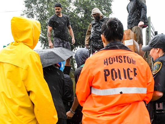 Volunteers and First Responders help flood victims evacuate to shelters in Houston, TX. Monday, Aug. 28, 2017.