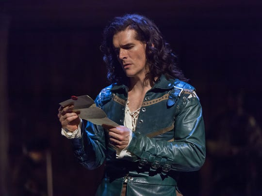 """Nicholas Carrière, as Will Shakespeare, reads a letter from Viola de Lesseps, the noblewoman who becomes is muse in the Playhouse in the Park's production of """"Shakespeare in Love."""" The show runs through Sept. 30 in the Playhouse's Marx Theatre."""