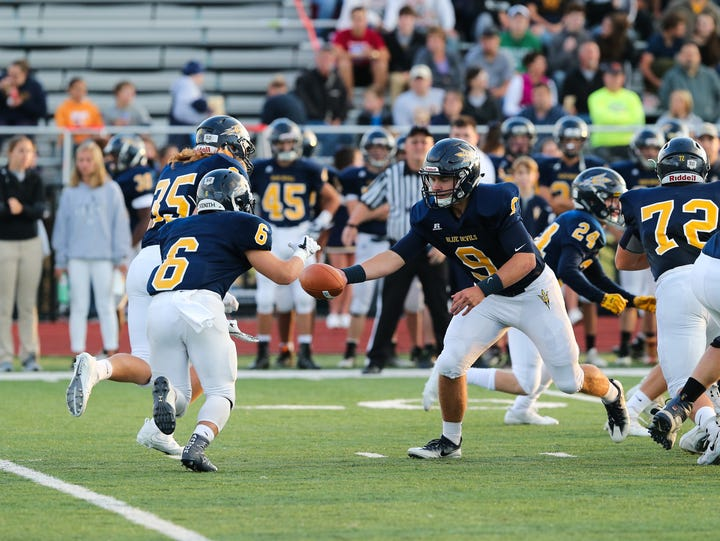Greencastle's Cade Mcdowell hands off the ball to teammate