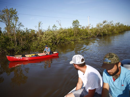 Don Cochran canoes from Everglades City to try to get back to his home in Chokoloskee on Sept. 11.