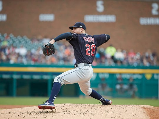 Indians starting pitcher Corey Kluber makes a pitch