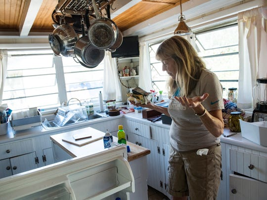 Fran Galloway of Tybee Island looks at the flood damage