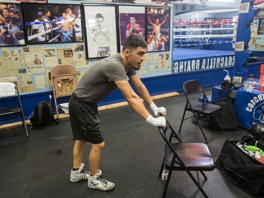 Randy Caballero rests in between routines during a training session in preparation for his bout against Diego De La Hoya on September 16, 2017.