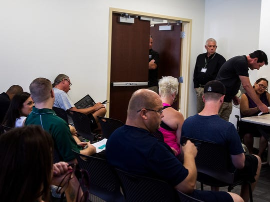 Bidders are pictured at the end of an HOA foreclosure