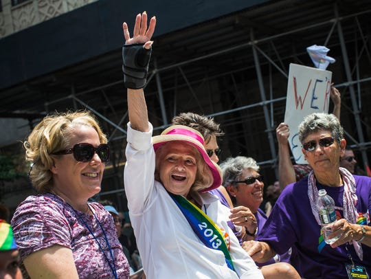 Edie Windsor waves to revelers at the New York Gay