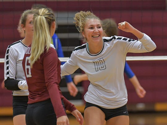 Jordyn Ellis (10) of Winneconne celebrates a point with her teammates in a Sept. 14 match against Campbellsport.