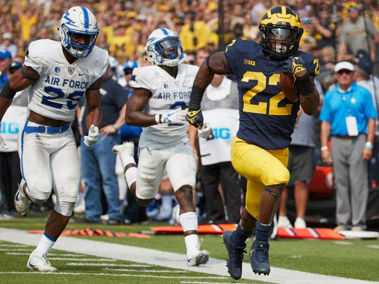 Michigan Wolverines running back Karan Higdon (22) rushes for a touchdown in the second half against the Air Force Falcons at Michigan Stadium.