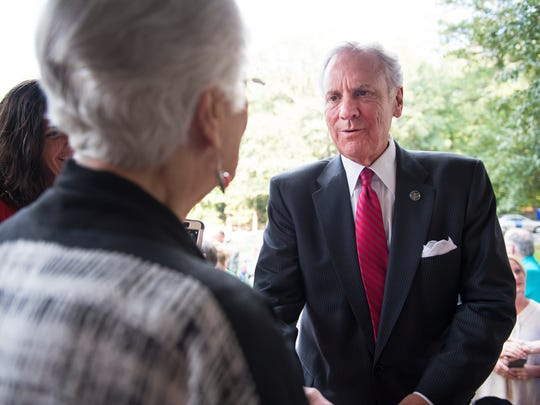 Governor Henry McMaster shakes hands with a member