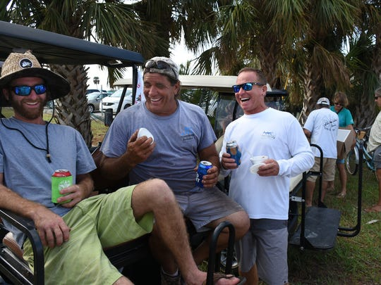 Isles of Capri residents who had been dealing with the aftermath of Hurricane Irma got together Tuesday evening for a hot meal and cold beer and frozen yogurt, courtesy of local merchants.