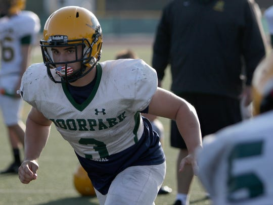 Jeremy Harris runs a play during Moorpark High's practice