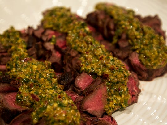 Grilled top sirloin steak with chimichurri sauce is