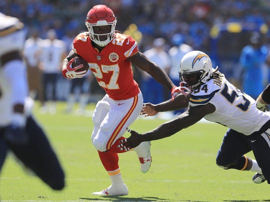 Rookie running back Kareem Hunt of the Chiefs, who had a 69-yard touchdown run, breaks away from Melvin Ingram of the Chargers. Hunt finished with 172 yards on 17 carries.