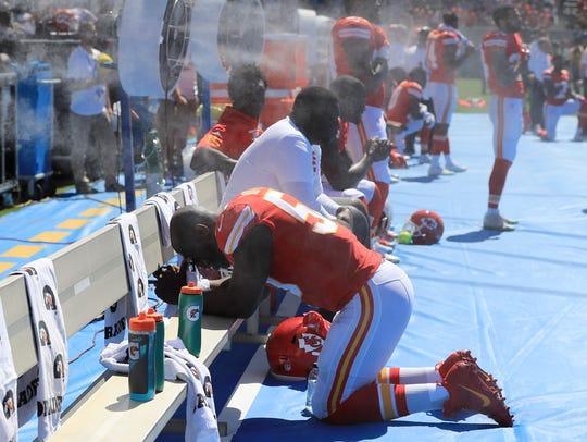 Justin Houston of the Kansas City Chiefs takes a knee